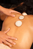 Hot stones massage Royalty Free Stock Photos