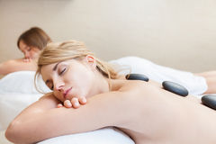 Hot stones massage Stock Photography