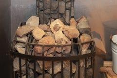 Hot stones in the sauna bath - Finnish sauna. Stones in the sauna heater close-up.