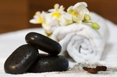 Hot stones stacked in natural wellness enviroment Royalty Free Stock Images