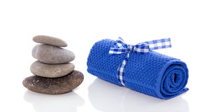 Hot stones and a towel Stock Photos