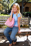 Hot student on cell phone. University student gossiping on cellular phone Stock Photography
