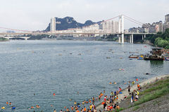 Hot summer day. A hot summer day in city,people go swimming in the river.Liuzhou,China Royalty Free Stock Photography