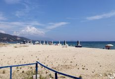 Hot summer day in Asprovalta, Greece. Sandy beach in Asprovalta city in Greece. Mediteranean sea landscape. Summer day next to the sea Royalty Free Stock Photography