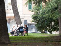 Eldery people pleasant time. On hot summer days eldery people go to Savona city gardens to have  fresh and calm moments Stock Images