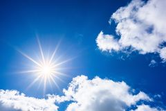 Blue sky with bright sun stock image