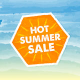 Hot summer sale in orange label over sea background Stock Photo