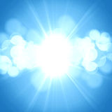 Hot summer sun. On a blue background Stock Photography