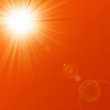 Hot summer sun. On a red background Royalty Free Stock Photography