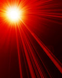 Hot summer sun. On a red background Stock Photos