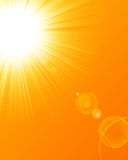 Hot summer sun. On a yellow background with room for copy Royalty Free Stock Image