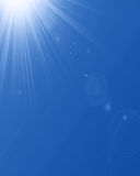 Hot summer sun. In a blue sky Royalty Free Stock Images
