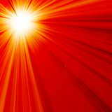 Hot summer sun. In a red background Royalty Free Stock Photos