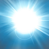 Hot summer sun. On a blue background Royalty Free Stock Photo