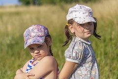 Hot Summer. Two little girl posing for the camera stock photography