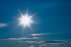 Hot Sun. On deep blue sky with few clouds Stock Images