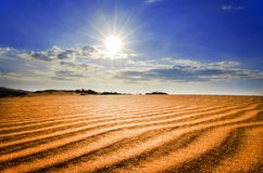 Hot Sun Under Red Sand Dunes. Royalty Free Stock Photography