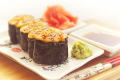 Hot sushi on plate with  chopsticks Royalty Free Stock Images