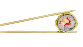 Hot sushi roll in chopsticks isolated Stock Images