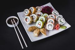 Hot sushi rolls table with gyoza. Avocado japanese colorful restaurant seaweed delicious nori cucumber seafood traditional tray shrimp plate salmon sesame fish royalty free stock photos