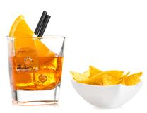 Hot tacos chips in front of glass of spritz aperitif aperol cocktail with orange slices and ice cubes Stock Image