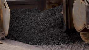 Hot tar mixed asphalt with stones. Best construction materials. Bitumen