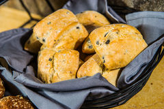 Hot tasty buns on a basket. Royalty Free Stock Images