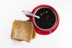 Hot tasty coffee in a red circle with a toast and a bun Royalty Free Stock Photo