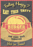 Hot, tasty, delicious burger. Promotional retro poster design with  Vintage style hamburger sign. On crumpled paper background. Text message Eat this tasty Royalty Free Stock Images
