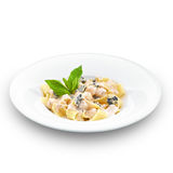 Hot tasty pappardelle with sweet pear and walnuts. Stock Image
