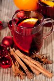 Hot tasty spicy mulled red wine with orange and cinnamon christmas Royalty Free Stock Photography
