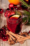 Hot tasty spicy mulled red wine with orange and cinnamon christmas Stock Photos