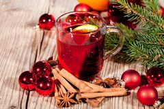 Hot tasty spicy mulled red wine with orange and cinnamon christmas Royalty Free Stock Images