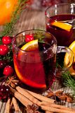 Hot tasty spicy mulled red wine with orange and cinnamon christmas Royalty Free Stock Photos