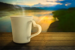 Hot tea. A cup of hot tea in the middle of nature environment Stock Image
