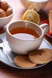 Hot tea. With lemon and biscuits Royalty Free Stock Images