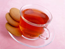 Hot tea. With cookies on the pink serviette Royalty Free Stock Photography