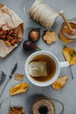 Hot tea, almonds, cookies, honey, figs, dry leaves, lavender on Royalty Free Stock Photos
