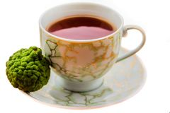 Hot tea with bergamot on white background in the cold. Winter stock image