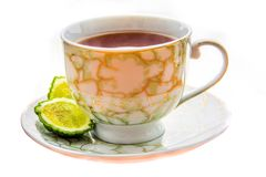 Hot tea with bergamot on wooden table in the cold. Hot tea with bergamot on white background in the cold. Winter stock photo