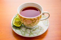 Hot tea with bergamot on wooden table in the cold. Winter royalty free stock photos