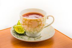 Hot tea with bergamot on wooden table in the cold. Winter royalty free stock photo