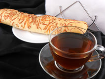 Hot tea with bread on black background Royalty Free Stock Image