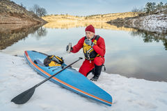 Hot tea break during winter paddling Stock Photography