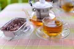 Hot tea and  cake. Hot tea and chocolate banoffee cake Stock Photos