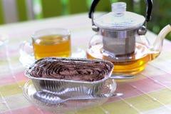 Hot tea and cake. Hot tea and chocolate banoffee cake Stock Photo