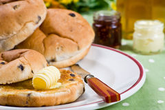 Hot tea cakes with melted butter, jam and honey Royalty Free Stock Images