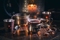 Hot tea with candle Royalty Free Stock Images