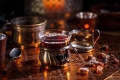 Hot tea with candle Stock Images