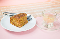 Hot tea and carrot cake Stock Images
